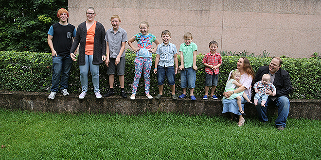 Family of faith: Michelle and Jeremy Dart with their nine beautiful children. Photo: Emilie Ng