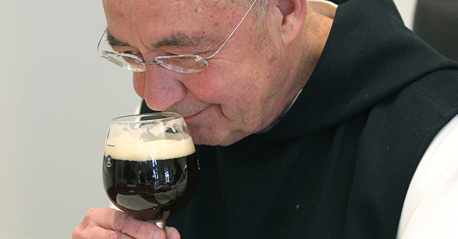 Taste test: Trappist Father Isaac Keeley takes a whiff of Spencer Trappist Ale during an April 29 taste-testing at the new state-of-the-art brewery on the grounds of St Joseph's Abbey in Spencer, Massachusetts. The monks began operating the first American Trappist brewery about a year ago. Photo: CNS/Chaz Muth