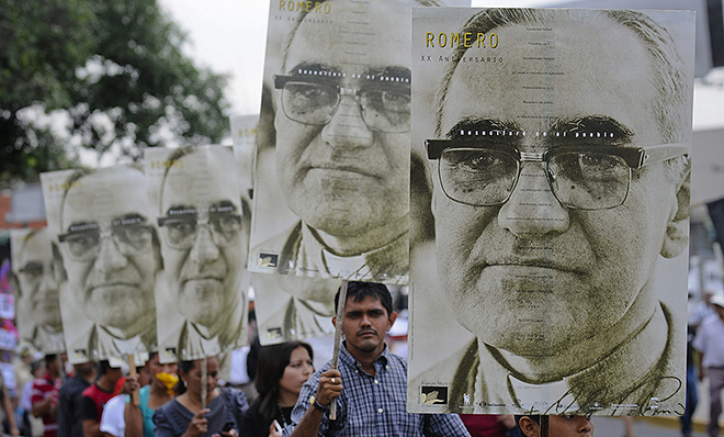 Dearly loved: People carry large portraits of Salvadoran Archbishop Oscar Romero during a rally in late March in San Salvador to pay tribute to the late archbishop, who was assassinated 35 years ago. Photo: CNS
