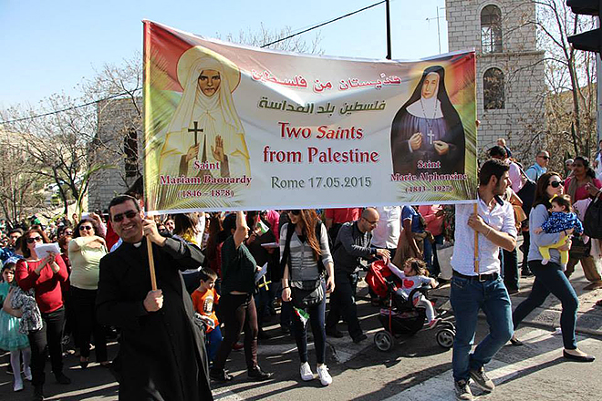 Palestine joy: Palestinians carry a banner in a recent procession proclaiming the nation's two new saints – Marie-Alphonsine Danil and Mariam Baouardy.