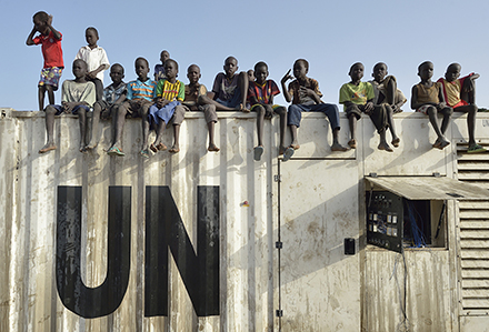 UN haven: Children sit atop a structure on April 8 inside a UN base in Malakal, South Sudan. More than 20,000 civilians have lived inside the base since shortly after regional fighting broke out in December 2013, but renewed fighting in 2015 drove another 5000 people into the relative safety of the camp. Photos: CNS/Paul Jeffrey
