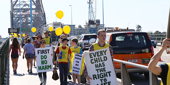 Stopping abortion: Pro-life supporters cross Story Bridge during their walk from Bowen Hills to Parliament House.