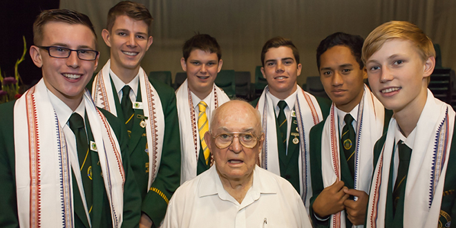 Devoted chaplain: Divine Word Missionaries Father Liam Horsfall with students from St Patrick's College Shorncliffe after a Mass to honour his commitment to the college.