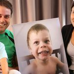 Hope amidst grief: Anthony, Jacinta and Michael Goodwin with a cherished photograph of young Joseph taken last Christmas.