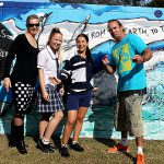 Art wall: Assisi teacher Jo Gordon with students Kirsten Podmore and Abby Ryan and artist Garth Jankovic and one side of the finished mural.