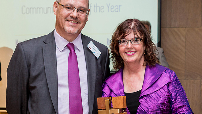 Recognition: 2014 Community Leader of the Year award winner Pam Radcliffe receiving her award from Catholic Church Insurance state manager Hugh Easton.