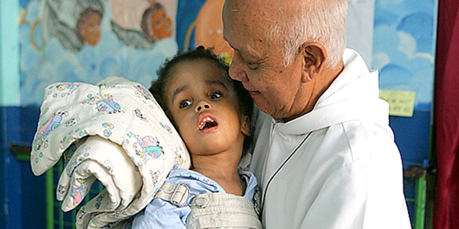 Work of compassion: Fr Richard Ho Lung caring for children living in poverty in Jamaica.