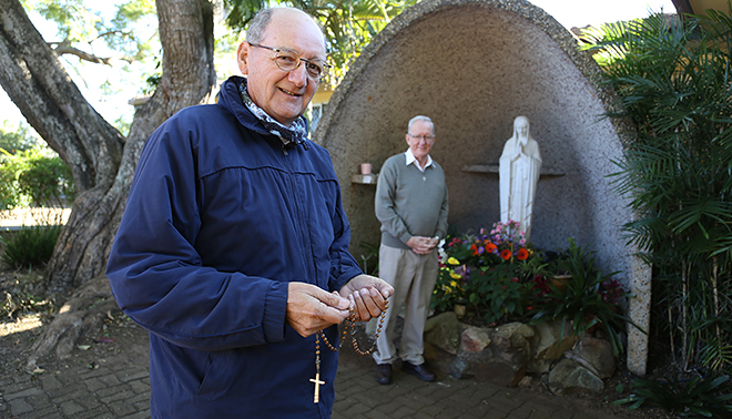 Marian power: Yvan Maurice, with the support of Sunnybank parish priest Fr Dan Ryan, is calling on Mary through the Rosary to help priests around the world. Photo: Emilie Ng