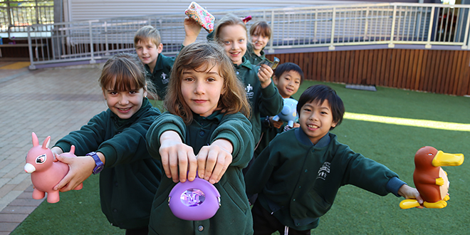 Helping others: Year 7 students Mya Hillman (centre) and friends Asha Cahill, Alex McAvoy, Elise Welsh, Natalie Welsh, Adrian Chan and Max Chan gave their pocket money to help a school in East Timor.