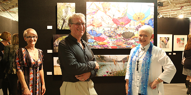 Creative endeavour: Curator Fiona Forrest, photographer Robin Cox and St Vincent's Private Hospital general manager Cheryl Royle at the launch of the hospital's Outside In art exhibition.