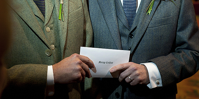 Marriage shift: A same-sex couple from England holds their British marriage certificate on March 29. Photo: CNS/Will Oliver, EPA