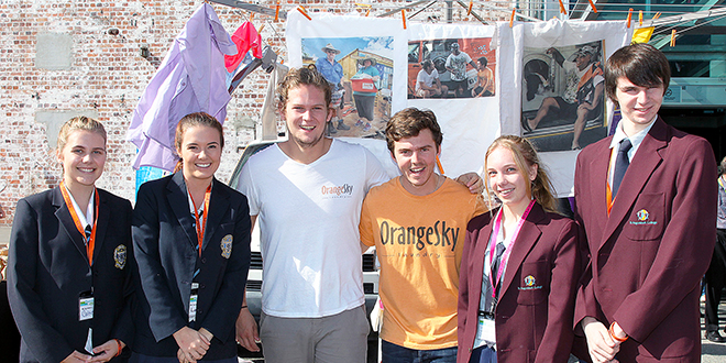 Inspiring students: Orange Sky Laundry founders Lucas Patchett and Nicholas Marchesi (centre) with Catholic school students at this year's Brisbane Powerhouse of Leaders event.