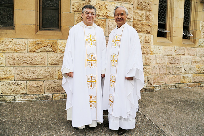 Life of service: Carmelite Father Paul Chandler and Fr John Khoai are celebrating 40 years of priesthood.