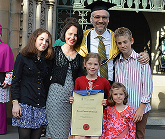 Father graduate: John Paul II Institute for Marriage and Family masters graduate James McDonald with his family outside St Patrick's Cathedral, Melbourne. Photo: Hannah Hladik.