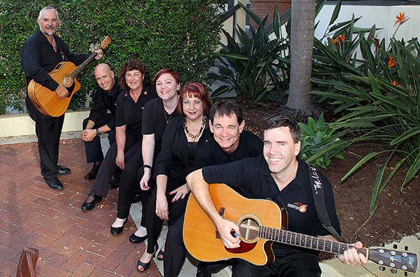 Spiritual and musical: MusicFire members (from left) Lawrie Knott (guitar/vocals), Paul Castelli (guitar/vocals), Anna Shaw (guitar/vocals), Stephanie Unger (keys/vocals), Jo-Anne Boyle (vocals), Mark Beiers (bass) and Gavin Agnew (guitar /vocals). Absent are Keith Beiers (percussion), Nathan Kneen (vocals), Peter Olley (keys/vocals), Bettrys Lowe (keys) and Barbara Hutton (flute).