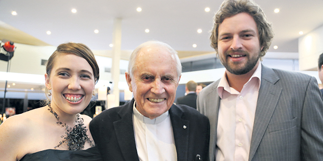 Cherishing life: Fr Gregory Jordan with Sarah and Nat Hutton at the Cherish Life Queensland annual dinner in 2013. It was an organisation he heavily supported.