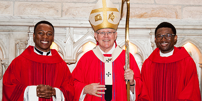 Faithful servants: Archbishop Mark Coleridge with Fr Paul Eloagu (left) and Fr Odinaka Nwadike after their ordination at St Stephen's Cathedral on June 29. Photo: Alan Edgecomb