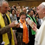 Papal encouragement: Pope Francis meets with members of the European Cursillo secretariat (from left) Christine Koptik, Raboert Nagl and Cristina Gawlas. The Pope is holding their gift of a heart–shaped gingerbread cake with Cursillo's De Colores rainbow symbol.