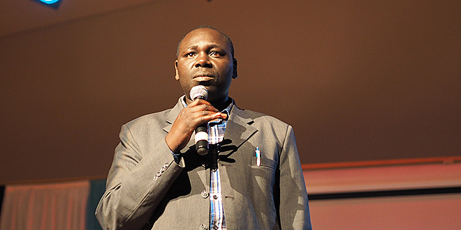 Call to action: Gerard Ndagijimana addresses the Logan Assembly.