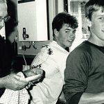 Picthing in: Bishop John Gerry helps out with the washing up during a visit to Boystown, Beaudesert, in 1989.