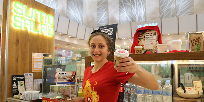 Making a difference: SumoSalad store manager Whitney Chapman offering free soups to Brisbane's homeless as part of a national partnership with the St Vincent de Paul Society.