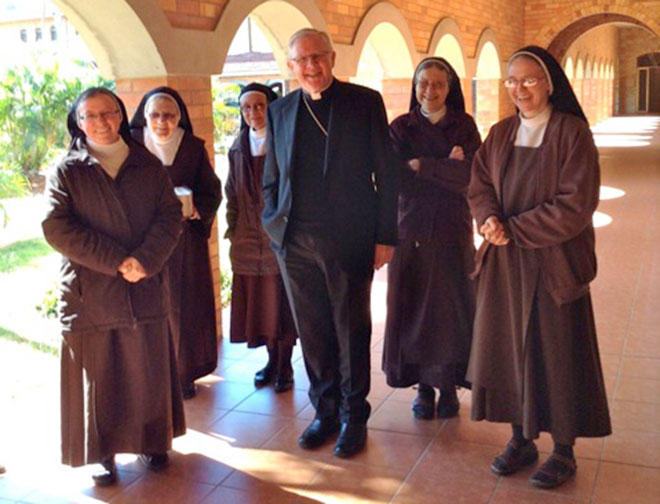 Episcopal visit: Brisbane Archbishop Mark Coleridge pays a visit to Ormiston's Carmelite community.