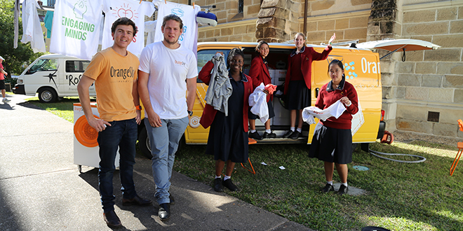 Serving others: Orange Sky Laundry founders Nicholas Marchesi and Lucas Patchett with Mary MacKillop College students Sierra Turay, Lauren Abraham, Keeley Hobday and Annalain Mape.