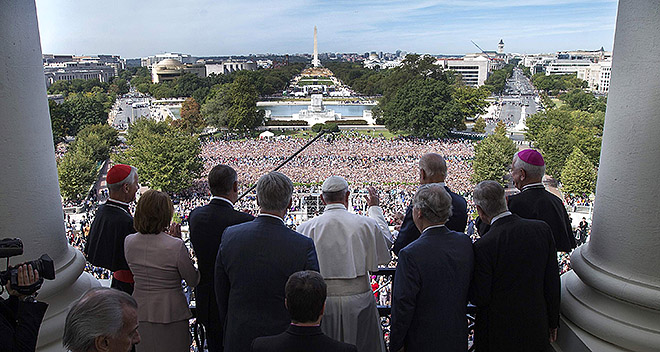 Capitol welcome: Pope Francis is welcomed to the Speakers Balcony at the US Capitol by members of Congress Sept. 24.