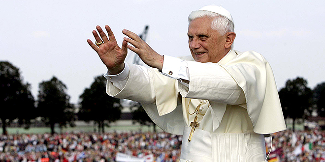 """Wise guide: Pope Benedict XVI responds to the cheers of World Youth Day pilgrims as he cruises in a boat down the Rhine River in Cologne in 2005. Pope Benedict said proponents of the digital age who exchanged information were sharing """"their view of the world, their hopes, their ideals"""". Photo: CNS"""