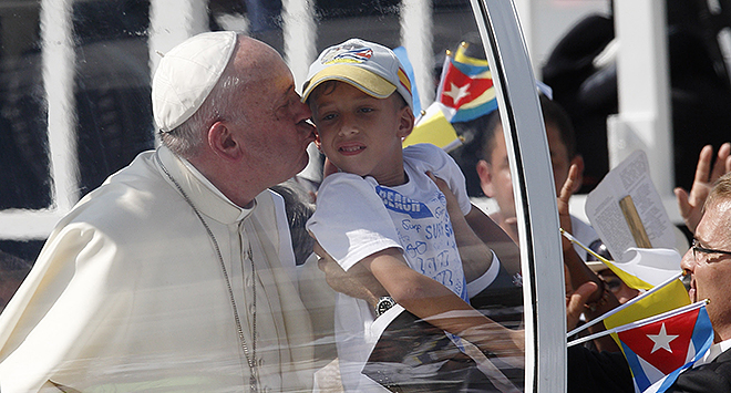Gaze at Jesus: Pope Francis kisses a child as he arrives to celebrate Mass in Revolution Square in Holguin, Cuba, on September 21.