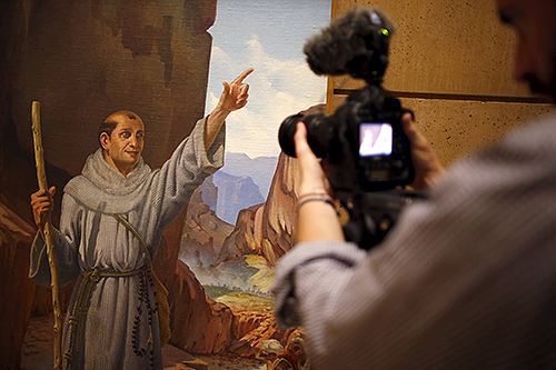 A member of the media takes images of a painting of Blessed Junipero Serra in an exhibit dedicated to the Spanish missionary at the Cathedral of Our Lady of the Angels in Los Angeles. The Franciscan friar and founder of the California mission system was canonised by Pope Francis on September 23 in Washington. Photo: CNS