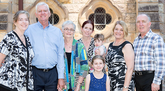 Family joins in: Bob and Bernice Muir (second and third from left), of Victoria Point, celebrate 50 years of married life together with family at the Golden Wedding Anniversary Mass at the Cathedral of St Stephen.