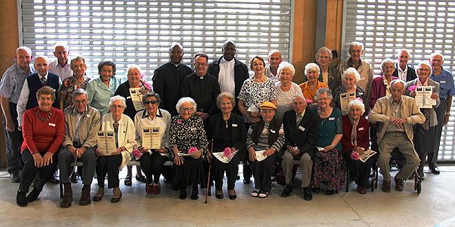 Seniors honoured: Some of the older parishioners from Moorooka-Salisbury gathered for a feast organised by their priest Fr Henry Maduka, pictured with Monsignor Peter Meneely and Fr Francis Onwunali.