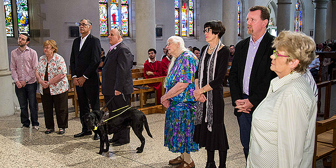 Blessing: Members of Brisbane archdiocese's Catholic Justice and Peace Commission are called forward during the Social Justice Sunday Mass in St Stephen's Cathedral last Sunday to be blessed by Archbishop Mark Coleridge for their work. Photos: Alan Edgecomb