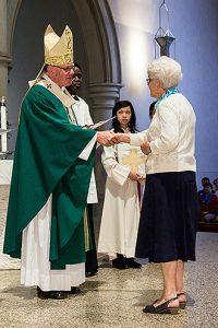 Gratitude: Archbishop Mark Coleridge hands out certificates of gratitude to people who have worked in parishes in support of the work of the archdiocese's Catholic Justice and Peace Commission.