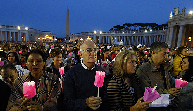 Faith renewal: People hold candles during a prayer vigil for the Synod of Bishops on the family attended by Pope Francis in St Peter's Square. Photo: CNS