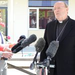 Hobart Archbishop Julian Porteous with press