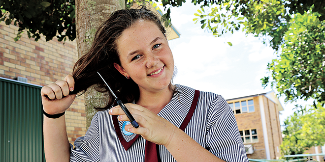 Cure for cancer: Teenager Carly Galligan survived leukaemia but will shave her hair to help find a cure for other cancer