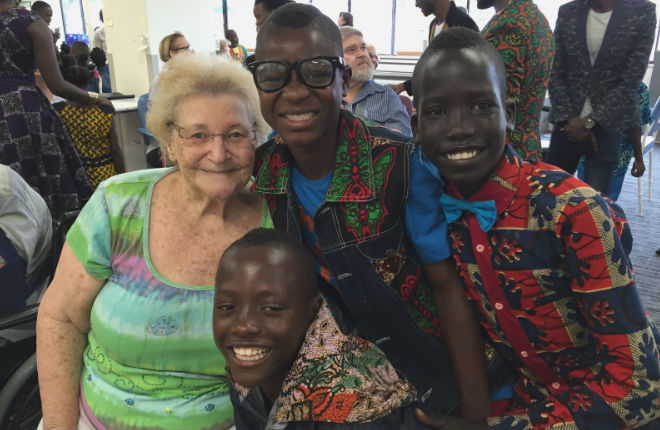 Lyrlene Schipplock with Watoto Children's Choir members