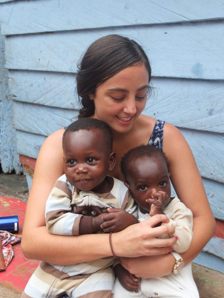 Helping hand: 2014 volunteer Natalie Scicluna looking right at home with children from the Royal Seed Home.