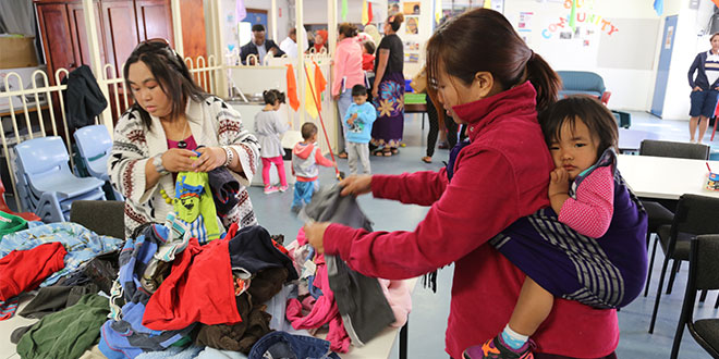 Offering hope:  Women check out children's clothes offered for refugee and asylum-seeker families at St Paul's parish. Photo: Mark Bowling
