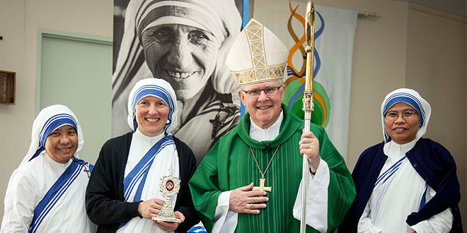 Precious gift: Brisbane Archbishop Mark Coleridge with Missionaries of Charity Sisters, Sr Antonella, Sr Milada holding the relic of St Teresa of Kolkata and Sr Maria Domini at the celebration of the canonisation of Mother Teresa of Kolkata at Marsden in Brisbane archdiocese last Sunday. Photo: Alan Edgecomb