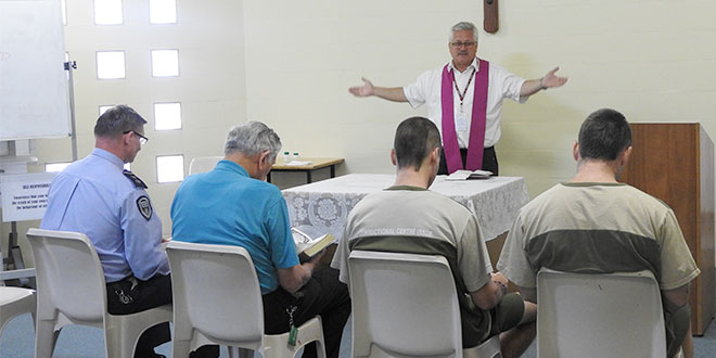 Mercy call: Fr Tony Girvan celebrates Mass in the prison chapel at Maryborough Correctional Centre.