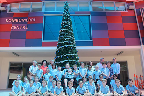 Great expectations: Guardian Angels' students gather around the seven-metre Christmas tree which they helped decorate. Photo: Supplied.