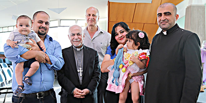 Iraqi refugees with Archbishop Casmoussa