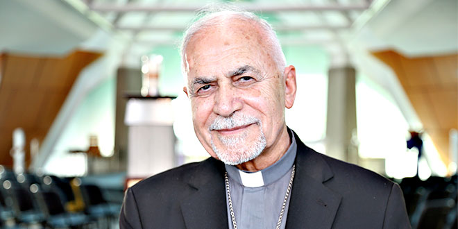 Welcome visitor: Archbishop Georges Casmoussa at St Joseph's Church, Bracken Ridge, where he visited refugee families from Iraq. Photo: Emilie Ng