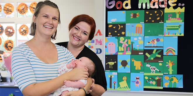 Teacher and mother with baby