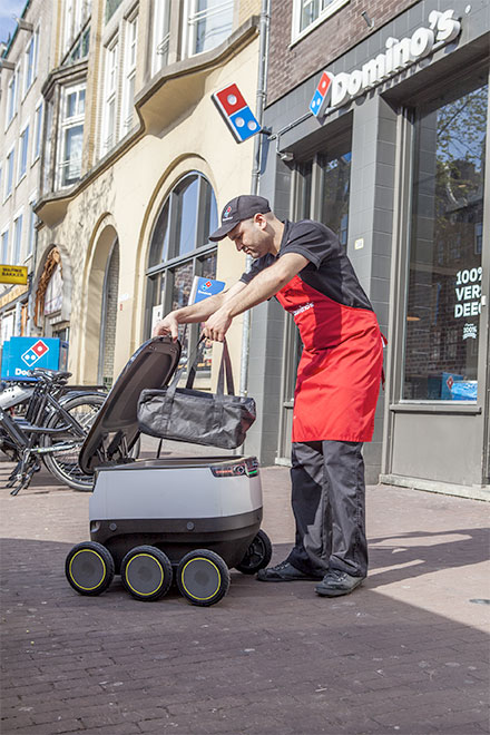 Robot delivers pizza
