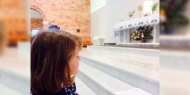 Child adores the Blessed Sacrament