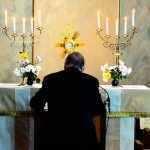 Archbishop Coleridge in adoration